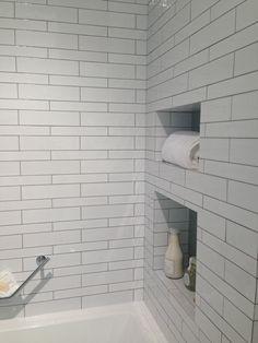 2 sizes of White subway tile w/ gray grout