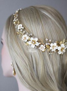This exquisite Bridal headband is for a Bride who is looking for a trendy yet timeless statement piece. Perfect for a garden wedding. Inspired by the beauty of wild roses, this floral bridal halo features handcrafted clay flowers and gold leaves. This bohemian headpiece going all