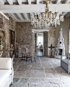 stone walls, exposed beams, stone floor, chandelier, fireplace
