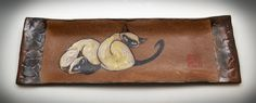 Brown stoneware tray with textured handles has a pair of siamese cats handpainted by Tracie Griffith Tso.
