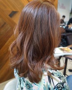 Natural wood brown is a classic hair color favourite! Style it with loose waves for an effortlessly chic look.