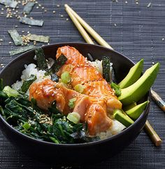 Teriyaki salmon rice bowl with spinach & avocado on a bed of sushi rice, sprinkled with sesame & nori • a festive healthy rice bowl from Panning The Globe