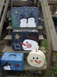 This time of year, snowmen tend to take over. They show up everywhere!    On suitcases.    And wreaths.    On sleds (seems appropriate)   ... Christmas Snowman, Winter Christmas, Christmas Holidays, Christmas Decorations, Painted Suitcase, Suitcase Decor, Snowman Crafts, Christmas Projects, Holiday Crafts