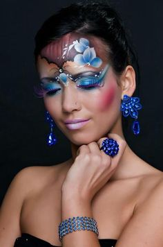 Colorful floral themed fantasy make-up with crystal accents.