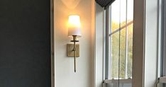 Super easy trick to light up sconces anywhere without electricity! Easy DIY that will work with just about any sconce light fixture.