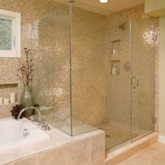 transition from tub to shower with bench, glass enclosure, steam shower, two heads, recessed shelves with accent tile behind
