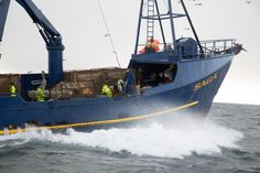 Preparing to launch a crab pot in the Bering Sea
