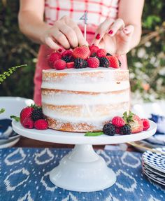 Save this summer dessert recipe to make a Naked Vanilla Cake with Lemon Cream Cheese Frosting for your outdoor pool party.