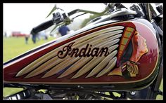 Although this is an older Indian motorcycle, the artist's painting is new and  beautiful in its simplicity and elegance.   AF-S Nikkor 17-35mm f/2.8D IF-ED at 26mm on a Nikon D700  f/4.5  1/80  ISO 200   Post Production: Aperture 3.0.3 & BorderFX