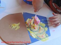 Fun with puffy paint and cupcakes in preschool.   ...& then you can make/eat real cupcakes =)