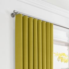 Ripple fold curtains.  Much cleaner and more modern than grommet curtains
