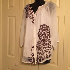 """Creme Colored 2 piece blouse set Creme color with brown leopard designs. 3/4 sleeves. Measures 28"""" from top of shoulder to hem line. Has a Creme colored camisole underneath the blouse.  Neckline slightly gathered. Worn one time. AGB Tops Blouses"""