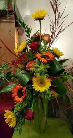 Autumn Flowers: Beautiful fall arrangment of Yellow and Orange Sunflowers, Roses, etc. in tall vase with dried branches and lush Ti leaves - Flower arrangements - Arrangements Funéraires, Funeral Floral Arrangements, Church Flower Arrangements, Beautiful Flower Arrangements, Altar Flowers, Flower Bouquet Diy, Diy Love, Memorial Flowers, Fall Flowers