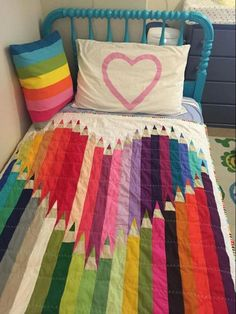 Rainbow heart, colored pencil bed quilt. Made by Craftsy member AnnieGetYourGlueGun