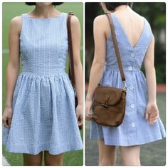 Cute Backless Buttons Mini Dress Material: Cotton Blend Color: White + Blue Sleeve Style: Sleeveless.                                                                                                                        Very cute style, Comfortable to wear. Price is firm unless bundle. Dresses Mini