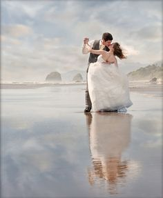 A waltz on the water! We love this romantic beach wedding photo.