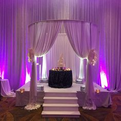 Circular wedding ceremony pipe and drape cabana and uplighting at the Hilton in Maryland