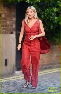 Sienna Miller Rocks Red Jumpsuit for London Shopping Trip: Photo Sienna Miller stuns in a red jumpsuit while doing some shopping! The American Woman actress was spotted stepping out on Friday (June in London,… Red Romper, Red Jumpsuit, Sienna Miller Style, Nick Lachey, Adidas Stan Smith Sneakers, London Shopping, Summer Lookbook, American Women, Style Me