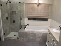 Gray and white marble bathroom with white subway tile