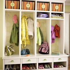 organized entryway lockers  with bins that have our initials on them, drawers, hooks, and shoe shelf. Maybe even color code it!