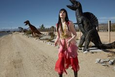 Captured next to dinosaur replicas, Lily Stewart models a Gucci dress with ruffles