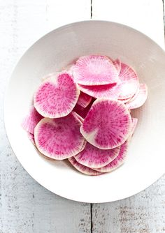 Quick dip (not deep) radish slices. Dust them with all spice, cumin, cayenne, garlic powder, onion powder, salt, sugar and ground coriander seeds. Healthy and super tasty snacks.