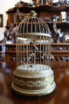 "Music Box Automaton. Bird Cage. 1920's French. THE CREATION OF BEAUTY IS ART."". ""If you want a golden rule that will fit everything. TO SEE BEAUTY NEVER GROWS OLD."". We also BUY Interesting Quality Antiques. 