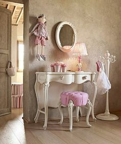 I could totally picture myself getting ready every morning at this vanity. So cute!