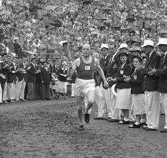 Olympic Games 19 July 1952 Paavo Nurmi brings the flame to light the cauldron inside the stadium Sports Figures, Summer Olympics, World Records, Track And Field, Olympic Games, Helsinki, Finland, Athlete, Around The Worlds
