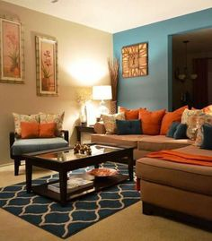 This interior space highlights the element of design of COLOR. The bright orange pillows really draws the eye in and the turquoise rug anchors the space in my opinion.