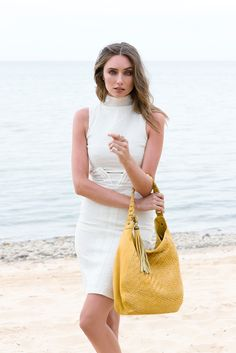 Model photographed with the Imani Woven Bag in Saffron #leatherbag #summerstyling