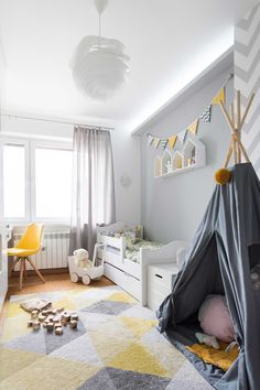 Grey and yellow kids room. Lovely teepee, geometric shapes, yellow accent, everything put together made the room very friendly for boy or girl.