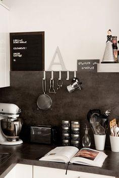 black & white kitchen w/ concrete counter tops.