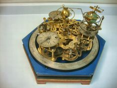 Clockwork driven orrery with Earnshaw type, split bi-metallic chronometer detent escapement with jewelled pivot and driven with chain fusee. Eight day duration.