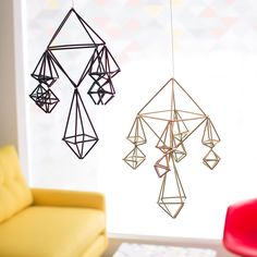 These modern, geometric mobiles from Brit + Co. look expensive, but are actually made from drinking straws. Diy Dorm Decor, Dorm Decorations, Pom Pom Mobile, Moon Crafts, Diy Crafts, Stylish Bedroom, Diy Bedroom, Bedroom Ideas, Bedroom Stuff