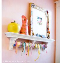 The large frame resting on the ribbon shelf is decorated with grandmother's old sewing notions, and it's covered -- a fun piece to study.