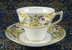 Rosina England Cup and Saucer Yellow Dog Roses On Brown Transfer