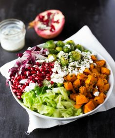 Kale Salad With Roasted Pumpkin, Brussels Sprouts, Goat Cheese + Pomegranate.