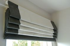 Prêt à Vivre | Design Ideas - roman blind with side and bottom borders pulled up