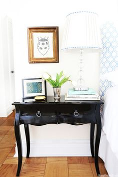 Ladybug art and nightstand styling