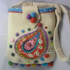 I made this bag from a rescued cream wool blanket, which I first fulled, then needle-felted with a paisley design. The bag is approximately 9 (22.9