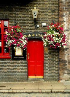 Red door with flowers.