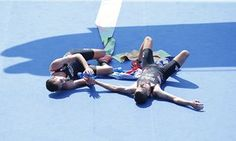 Alistair Brownlee, left, and brother Jonny celebrate their historic gold and…