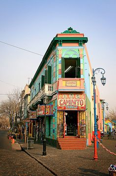 La Boca(dasse), Buenos Aires, Argentina. Oldest neighborhood, origin immigrants from Italian city of Genoa. Bright houses were painted from leftover paint from the shipyards.