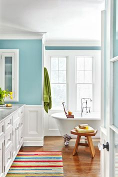 Crisp white trim and serene blue walls brighten the spacious new layout of this bath