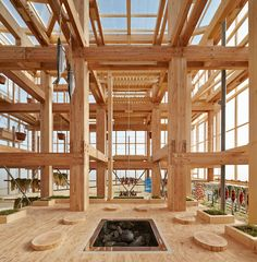 Nest We Grow in Hokkaido, Japan 5 Japanese architectural firm Kengo Kuma and a team of students at UC Berkeley's College of Environmental Design created 'Nest We Grow', an elaborate timber community food hub recently constructed on the island of Hokkaido. The structure's timber frame actually mimics the vertical spatial experience of a Japanese larch forest. The team added plenty of beams for hanging fish and produce and a central tea platform with a sunken fireplace. The building is…