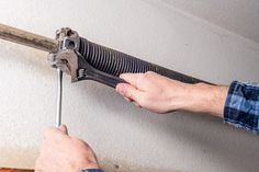 If they are experienced and know how to do it safely with the correct equipment – 99% of the time this is not the case. For safety and warranty assurances, garage door springs should always be replaced by an overhead door expert. When winding or unwinding the springs, they can snap without warning, which can result in serious injury. Garage Door Spring Repair, Garage Door Cable, Garage Door Torsion Spring, Garage Door Panels, Garage Door Company, Wooden Garage Doors, Broken Garage Door Spring, Garage Door Decorative Hardware, Garage Door Hardware