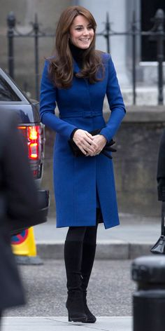 OCTOBER 23, 2015 Middleton stepped out in Scotland on Friday morning in a perfectly tailored cobalt blue coat (cinched at the waist by a matching belt) as well as a cozy turtleneck, tights, knee-high boots, and a feminine pair of gloves—all in black. An elegant pair of drop earrings elevated the seasonable ensemble.