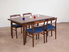 Danish Rosewood Extendable Dining Table with Rounded Edges by Ellegaards Møbelfabrik