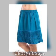 Darling turquoise fringe skirt Love these sassy little skirts. Fringe bottom and elastic waist. 100% rayon. Run true to size and made in India. Perfect alone or under a tunic. I have this in S-M and L Boutique Skirts Mini